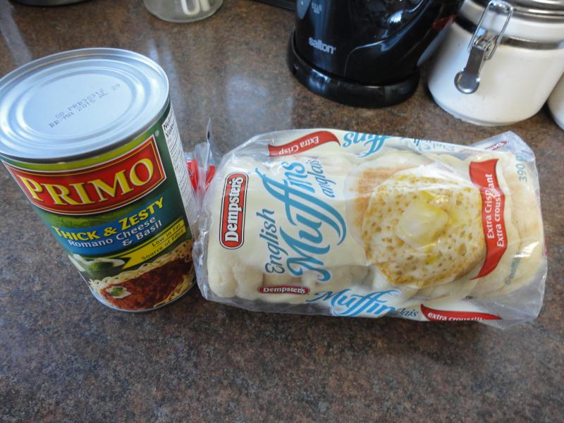 A can of pasta sauce and a package of English muffins